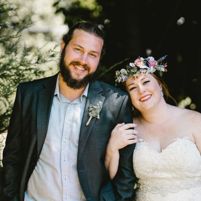 Beautiful Bride with her Groom. Bride wears a flower crown and white dress.